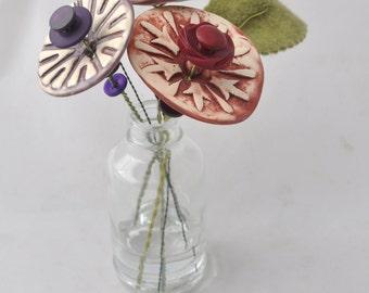 purple, burgundy, and eggplant button flower bottle bouquet