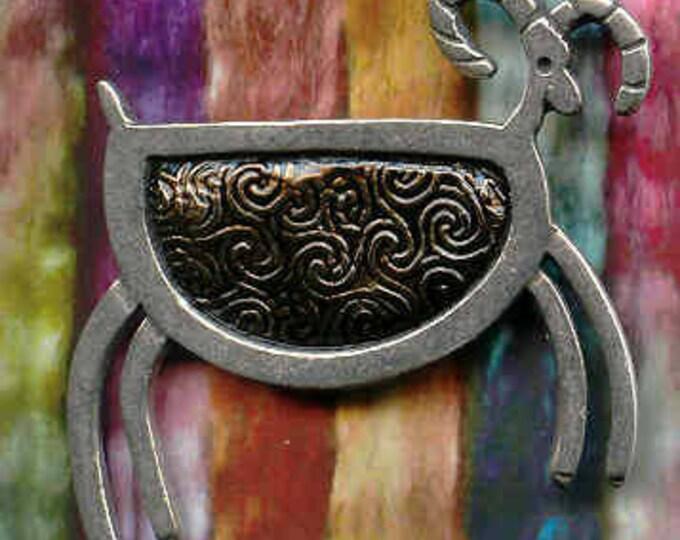 Black petroglyph pewter sheep brooch