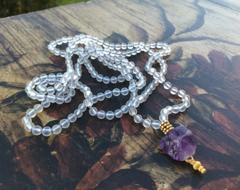 216 bead Mala featuring matte Crystal Quartz, 24k Gold vermeil accents, and a raw Amethyst Guru hand knotted on silk