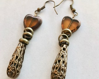 Baroque teardrop earring; antique bronze filigree with glass heart accent