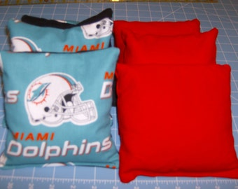 4 Miami Dolphins Corn Hole Game Bags and 4 Orange Duck Canvas Corn Hole Game Bags