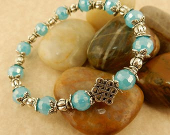 Silver plated Celtic Knot stretch beaded bracelet w/ Turquoise Blue 8mm Crystals