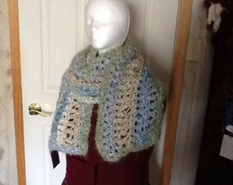 Oh so soft long warm scarf.  Homespun thick n quick bulky yarn.  Verigated colors of light blur, light green and cream.