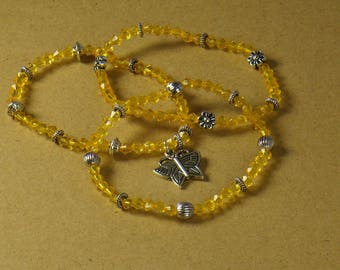 DESTASH. Set three orange and silver bracelets with a butterfly