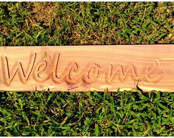 Welcome sign CNC carved into aromatic Cedar.