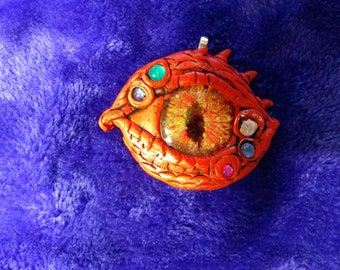 Unique hand-crafted polymer clay dragon's eye pendant with hand painted glass cabochon.