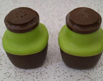 1970s vintage plastic salt and pepper shakers in olive and mission brown