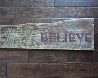 Reclaimed barn wood We Believe sign
