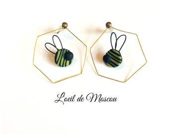 in its honeycomb bee earrings
