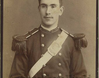 Handsome soldier officer antique cabinet photo