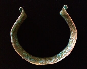 Beautiful turquoise colored patina on hammered brass cuff