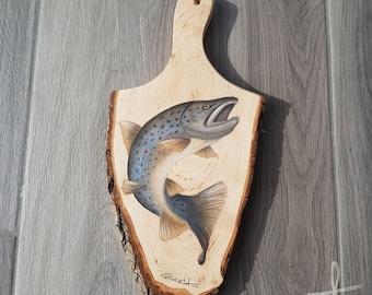 Portrait on wooden board brown trout