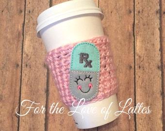 Happy pill appliqué crochet coffee sleeve, coffee cozy, feltie, felt appliqué, nurse coffee sleeve, pharmacist gift