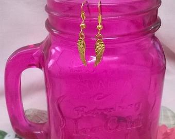 Tibetan gold feather earrings.