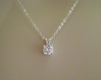 Sterling silver cubic zirconia pendant necklace; faceted cubic zirconia diamond necklace; small cubic zirconia necklace; classic necklace