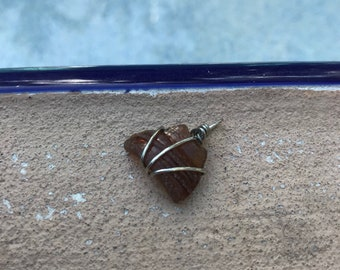 Small wire wrapped brown sea glass