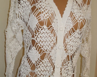 White crocheted vest.
