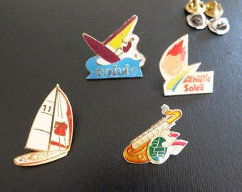 A collection of Vintage French enamel pin badges