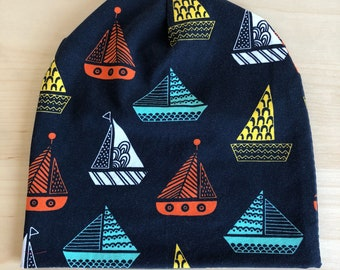 Dark blue cotton jersey toddler/child beanie with colored sailor boats