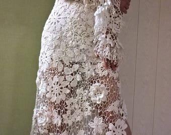 The dress is a white, dandy, Irish lace.