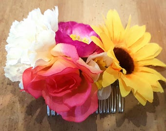 Bright artificial flower hair comb