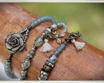 Three stackable antique brass and soft blue/gray czech bead bracelets