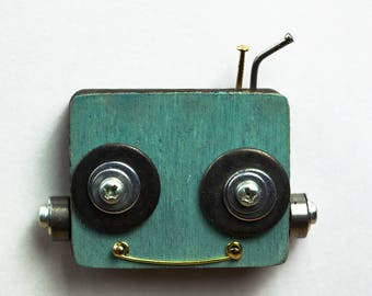 Green robot magnet with bolts and screws