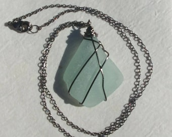 Large Frosted Sea Foam Green Genuine Beach Glass Sea Glass Wedge Triangular Shaped Gun Metal Wire Wrapped Pendant Necklace.