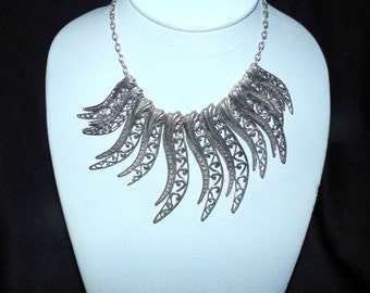 Interesting Statement Silver/Pewter Bib Necklace Very Ajustable
