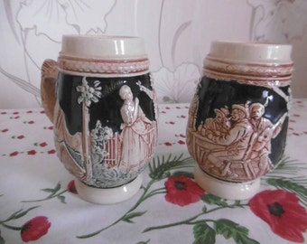 2 mugs with embossed ceramic German beer