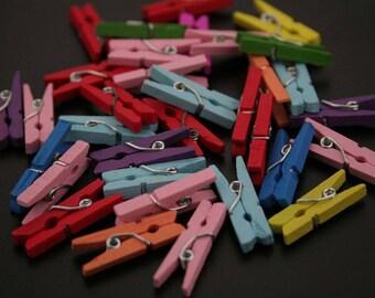 40 mini wooden clothespins. (ref:3657)