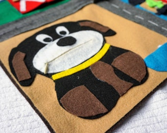 Felt mat with various activities for toddlers.