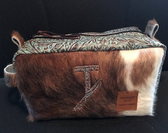 Cowhide and leather makeup or shaving bag.