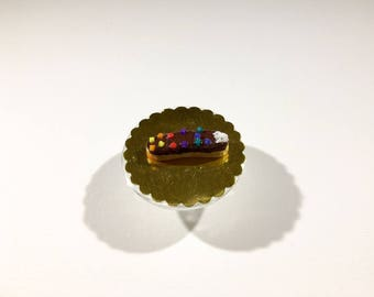 Chocolate frosting, colorful lozenges and whipped cream polymer clay miniature Flash