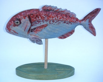 Scupture, wooden Fish on base.