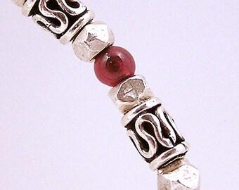 Sterling silver and garnet bangle bracelet
