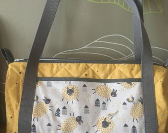 Cute diaper sheep pattern in shades of mustard yellow bag.