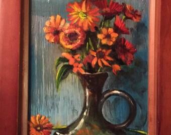 Orange flowers, black vase