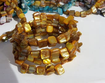 shell bracelet with 4 rows in Ochre yellow memory wire, gold orange