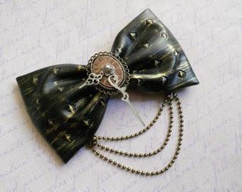 Steampunk hair bow gears and watch clock hands on a gold faux leather pleather pyramid embossed bow with chain