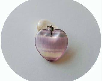Fluorite (gemstone) heart pendant.