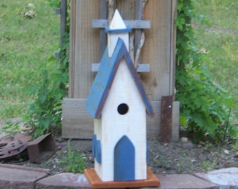 Blue And White Old Looking Birdhouse