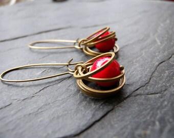Spinner rings and gemstone on long sleeper earrings