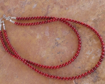 Coral red double strand necklace