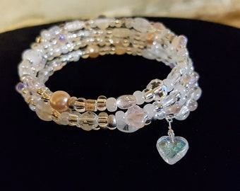Iridescent memory wire bracelet in shades of pink and white, crystals, pearls, heart
