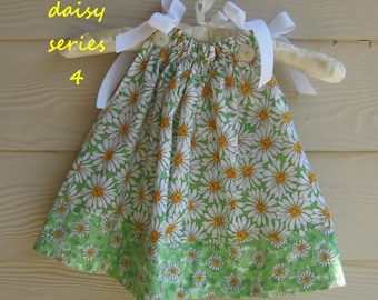 White Daisy Pillowcase Dress on a Green Background - 6 to 12 mth old -