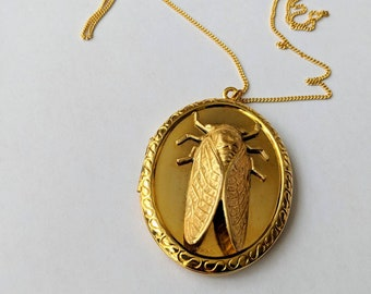 "Cicada locket pendant necklace on 24"" chain"