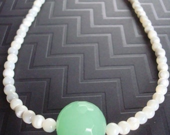 Natural shaped fresh water pearls with a green quartz focal bead