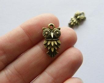 8 Owl charms bronze tone BC275