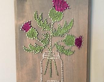 Thistle flower string art